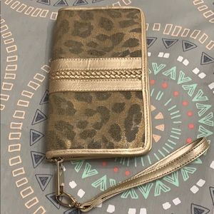Cache gold and leopard print hand bag